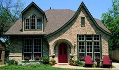 Beautiful exterior colors on this Tudor--possible choice for our house! The color scheme here utilizes colors by Valspar from Lowe's features base color Tea Leaves Green and trim Territory Green and Geranium Red