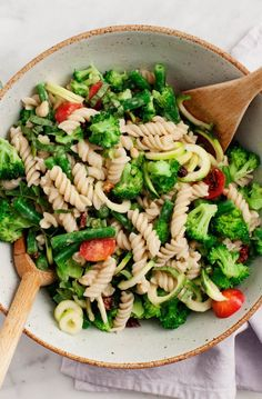 Healthier pasta salad made with creamy vegan tahini dressing, broccoli, green beans, zucchini, tomatoes and basil. Perfect for picnics and pot lucks.