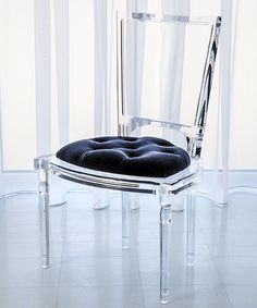 Marilyn Acrylic Side Chair - Admiral Blue - The presence of beauty is clear to see in the Marilyn Acrylic Side Chair - Admiral Blue. Italian molded clear acrylic forms the traditional silhouette of this simply styled furniture piece that features a tufted mohair cushion in rich blue. Whether placed at a dining room table or in a sitting area, the Marilyn chair brings a certain indefinable allure to its surroundings.