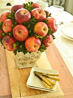 Turn Fresh Apples into a Rustic Centerpiece...Our step-by-step instructions show you how to put fall's bounty on display by covering a foam topiary form with sprigs of fresh greenery and apples or pears.
