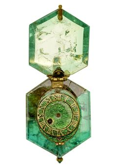 "o-mew: "" ufansius: "" Watch set into a single Colombian emerald crystal, circa 1600; the watch is part of the Cheapside Hoard, a cache of jewels and jewelry buried since the Great Fire of London in..."