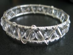 Wire wrapped bangle bracelet with clear beads by LeeliaDesigns,