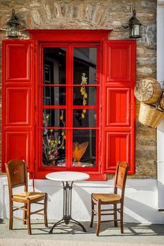 Vibrant red for this coffee shop. ~ Goodmorning from Amorgos ~ Greece