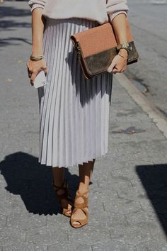 pleated midi skirt with oversized sweater and strappy heels