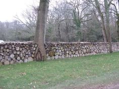 use firewood for walled fence