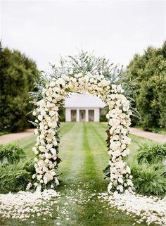Elegant White Rose Ceremony Arch photography / katiestoops