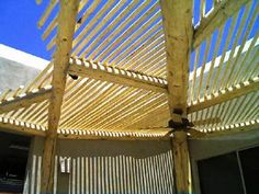 Curved southwest wood patio with split latillas on top for shade