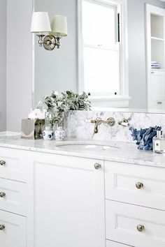 Browse our beautiful kitchen and Bathroom designs for inspiration. A palette of blue and white gives this East Coast American style renovation a timeless elegance and relaxed charm, with Perrin & Rowe nickel tapware the perfect complement.