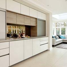 Streamlined white open-plan kitchen | Kitchen decorating | Beautiful Kitchens | Housetohome.co.uk