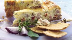 """Nestled on a buttery cracker crust, cream cheese takes on the flavor of savory ingredients in this elegant party """"dip."""""""