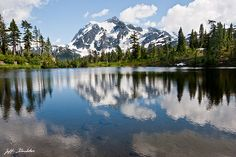 Because of its striking beauty, Mount Shuksan in North Cascades National Park is one of the most photographed mountains in the world.  This picture of the mountain, reflected in water was taken from Picture Lake in the Mount Baker National Forest in Washington State, USA.
