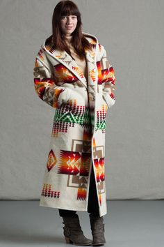 Reversible Long Coat, Chief Joseph, Ivory  Designed exclusively by Kraff's this reversible, long coat is a Native American inspired design.Made byKraff's using a Pendleton® blanket.This coat can be reversed to either side for a completely different look. A unique piece of Native American apparel, that will last for many years to come. Made with virgin wool for maximum warmth. Fabric made by Pendleton®. Designed, constructed, and sewn by Kraff's Clothing. Made in the USA.   Attached...