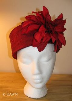 How to make a pillbox hat - #millinery blog showing steps on how to make and cover a buckram hat from scratch. No pre-made hat forms needed! This hat has a red silk covering, a red flower, and is lined in red and gold brocade.