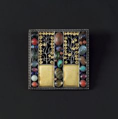 Josef Hoffmann. Brooch (1908) in silver, partly gilt, agate, amethyst, bloodstone, coral. jade, lapis lazuli. moonstone, opal, tourmaline. e...