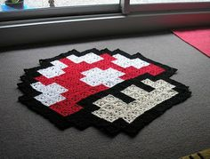 Pixelated mushroom rug! Cute!  The pattern for the squares and the design to follow you can find here: http://pixelatedmushroom.blogspot.com/2010/05/pixelated-mushroom-rug.html