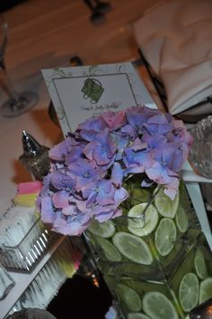 Table centerpieces at our wedding...limes in a square vase filled with water and purple hydrangeas.  Love.