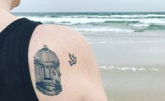 My tattoo, I'm in love with this picture of it!!❤❤❤❤ dove bird cage tattoo at the beach