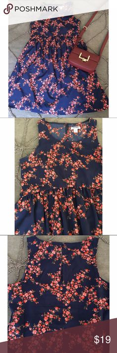 Old Navy Floral Swing Dress A comfy and flattering sleeveless swing dress in a light navy with pink floral detail. I got so many compliments when I wore this dress! Please feel free to make me an offer or request a bundle! I'm cleaning out my closet so all reasonable offers are considered 😊  🎁 Please no trades or PayPal! 🎁 Old Navy Dresses