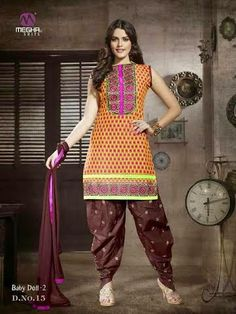 Beautifully Designed Orange Patiyala Dress in Cotton with awesome embroidery work done. Comes along with Brown contrast matching finely embroidered Bottom and Duppatta.