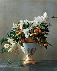 beautiful #vase with a spectacular flower arrangement with whites and oranges