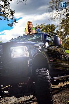 A girl with her diesel truck.  I could do this with my truck as long as they didn't scratch it.