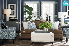 Bassett Rooms We Love!   * custom ottoman rectangle ottoman :: could do in that gray/white pattern of the circular ottoman and really like the studs along the bottom ** also like the blue paisley-esque pillows but doesn't say what pattern that is *