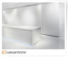 A complete white kitchen with Caesarstone floors, countertop, cabinet and wall covering