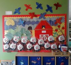 """My Classroom's """"Down on the Farm"""" Board (The children created puddles of mud, pigs, birds and painted the barn red.)"""