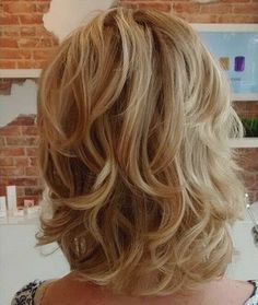 medium blonde layered hairstyle: