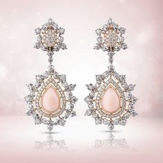 """@buccellatimilan. White gold leaves set with diamonds surround the lovely drop-shaped bezels in pink gold set with a coral contoured by a rivière in pink gold and diamonds. The """"Summer Lady"""" pendant earrings radiate beauty, femininity and allure. #Buccellati #HighJewelry"""
