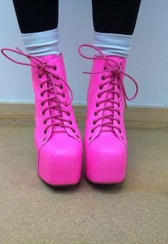 Neon pink lace-up boots...this looks like something Jeffree Star would love