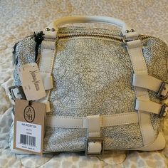 ASH white cracked leather. ASH white cracked leather. Comes with dust bag from last summer Neiman Marcuscollection. Very soft leather. Ash Bags
