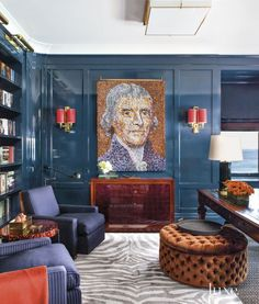 22. Lacquered Walls  This office's navy blue-lacquer paneling and Roman Thomas striped armchairs in a Ralph Lauren Home fabric are brightened by vivid color, such as in the tomato red of the shades on Maxime Old 1940s gilt-bronze sconces. A silk zebra-patterned Edward Fields rug adds depth. #LuxeTurns10