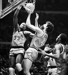 Patrick Ewing (33) ferociously dunks over Syracuse's Rony Seikaly during the semifinals of the 1985 Big East tournament.