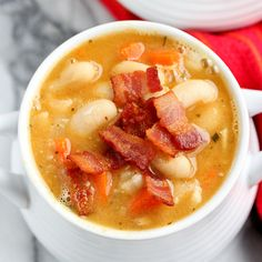 "White Bean and Bacon Soup.  I've been in a ""soupy"" kind of mood lately & this looks & sounds delicious!  I think I have to try it...come on cold weather, please get here!"