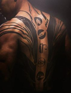 Four's(Tobias) tattoo on he's back
