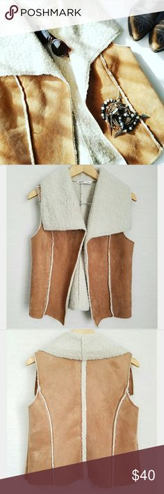 """Faux Suede Sherpa Lined Vest Such a great layering piece! Super soft faux tan suede with Ivory sherpa lining Large flap lapels  No closures Size M/L 15.5"""" cross shoulder  21"""" long Very good gently used condition  PLEASE READ CLOSET INFO AND POLICIES POST Old Navy Jackets & Coats Vests"""