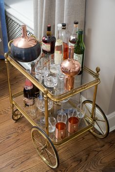 """What Happens When A Gossip Girl Decorator Makes Over Your Apartment  #refinery29  http://www.refinery29.com/jenny-han-brooklyn-home-tour#slide-7  Han does a lot of entertaining, so this French 1920s bar cart was a good investment. As far as when to invest in antiques, Tonkin says it's all about balance — like layering a vintage tchotchke on a modern table. """"I love using a client's family heirloom and repurposing that in a modern way,"""" she explains...."""