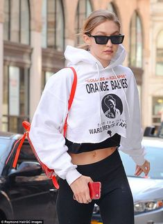 Representing: Hadid also wore a $275 Wardements x Orange Babies cropped white hoodie benefitting pregnant HIV-infected women and their babies in Africa