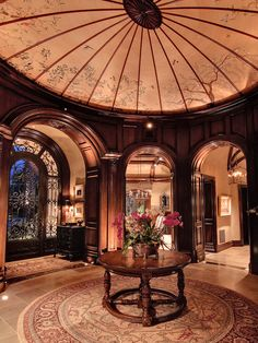 R.J. Gurley Custom Homes with domed ceiling. Japanese parasol blends well with the western wood work.