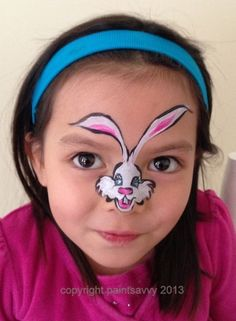 face painted easter bunny. These ones with a small figure in the middle of the face would be good for those children who don't have the patience or just do not want a full face painting...