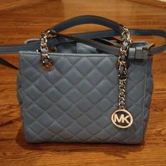 "FINAL PRICE ⬇️NWT Michael kors Susannah small tote Brand new Michael kors small Susannah tote in sky/silver.  10-1/2 x 8-1/2 x 4-3-4.  Quilted leather with a Signature logo charm.  10"" drop handles with an adjustable strap of 21-23"" drop.  Magnetic snap tab closure.  1 zip compartment, 4 slip pockets. Michael Kors Bags Totes"