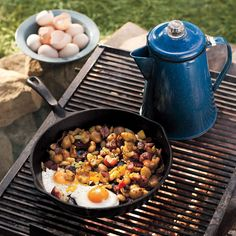 Cook the quintessential outdoorsy breakfast: eggs and potato hash fried in bacon drippings. Brew a fresh pot of cowboy coffee directly over the campfire to complete the meal.