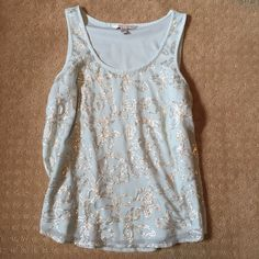Sequin Tank Sequin tank top by Lauren Conrad. Please do not ask to model as it is not my size. Feel free to ask any questions. Please make all offers through the offer button or bundle for a discount! Lauren Conrad Tops Tank Tops