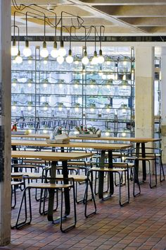 For the creation of two new eateries within the Barbican Centre, one of London's greatest 20th century architectural landmarks, architects and designers SHH assembled lighting designers PSLAB, furniture designer Stefan Bench and garden designer Kate Gould.  Read more at Design Milk: http://design-milk.com/barbican-foodhall-and-lounge/#ixzz1NyBz83Tc