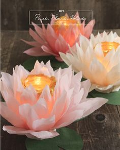 These beautiful paper flower votives are from The 100 Layer Cake blog. They have all the directions if you are interested in making your own. Check out these other paper flowers. Here