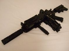 Guns Made Out Of LEGO lego gun.not so sure of the functional partlego gun.not so sure of the functional part Big Lego, Lego Dc, Lego Guns, Lego Army, Airsoft Gear, Star Wars Luke Skywalker, Lego Worlds, Cool Lego Creations, Lego Models