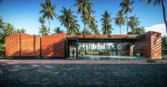 The Bangkok firm NPDA of Nutthawut Piriyaprakob built this dwelling on the southeastern Thai island of Ko Phangan. The 240-square-meter construction presents reddish brick walls decorated with diagonal stripes. Prominent among the rooms is a large...