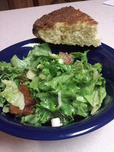 This is a traditional Appalachian meal in the spring. Fresh garden lettuce and onions are tossed with hot bacon grease and eaten with a piece of cornbread. Tastes even better sprinkled with a little vinegar.