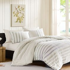 The INK+IVY Sutton Duvet Cover Set brings a modern update to the striped look with a smart combination of solids and stripes. Rich shades of pink, yellow, and grey give this beautiful bedding a crisp, yet casual appearance.